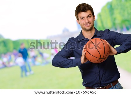 Portrait Of Young Man Holding Basketball, Outdoor - stock photo