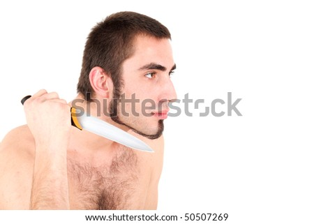 Portrait of young man holding knife in his hand - stock photo