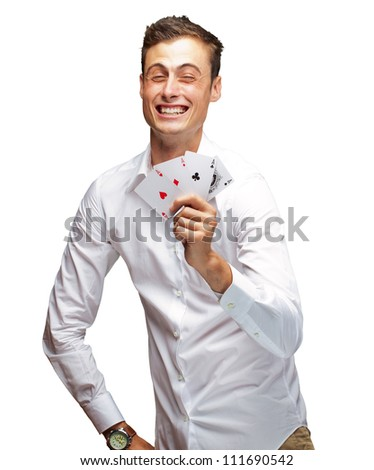 Portrait Of Young Man Holding Poker Cards Isolated On White Background