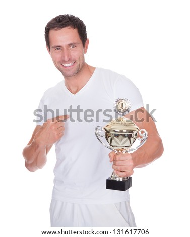 Portrait Of Young Man Holding Trophy Isolated On White Background - stock photo