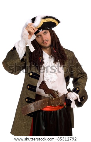 Portrait of young man in a pirate costume with pistol - stock photo