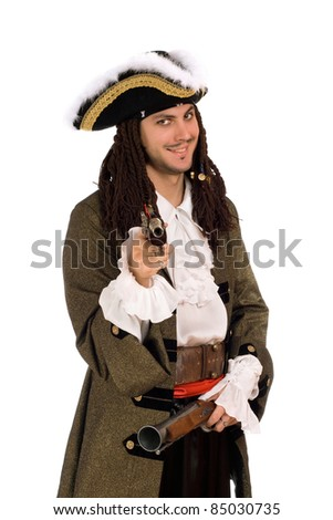 Portrait of young man in a pirate costume with pistols - stock photo