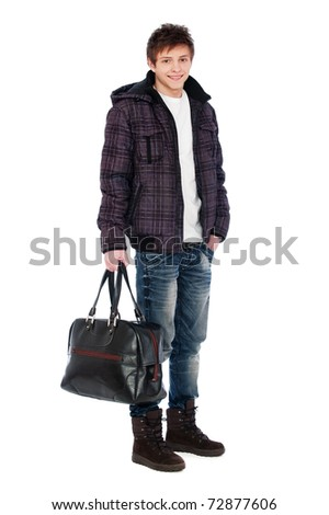 portrait of young man in coat holding bag - stock photo