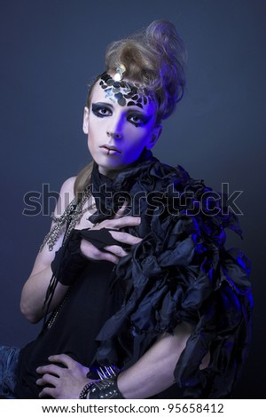 Portrait of young man in dark creative image - stock photo