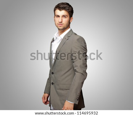 Portrait Of Young�Man In Formal On Gray Background - stock photo