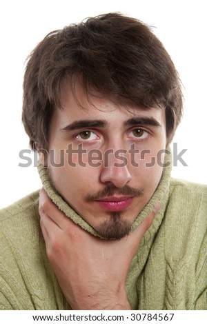 Portrait of young man in  green pullover suffering from  cold - stock photo