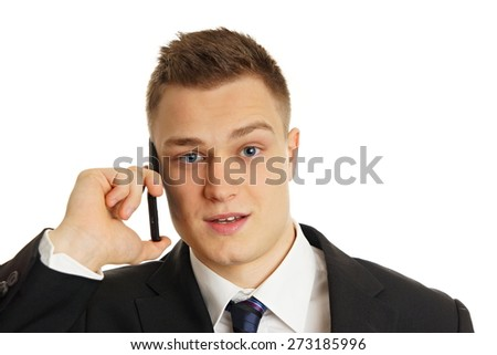 Portrait of young man in suit with mobile phone