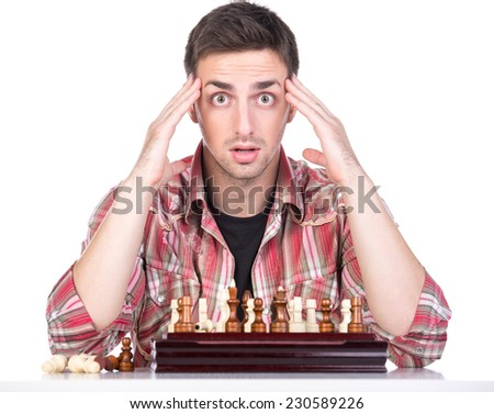 Portrait of young man is playing chess covered her face. He loses. - stock photo