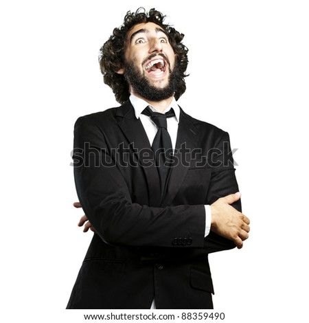 portrait of young man laughing against a white background