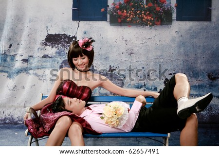 Portrait of young man lie on girl knee and looking to her face - stock photo