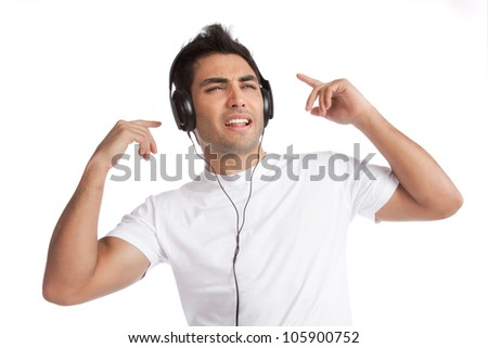 Portrait of young man listening music on headphone isolated on white background. - stock photo