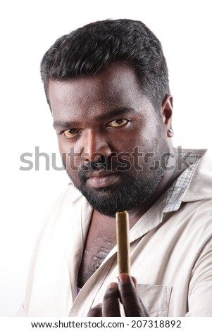 Portrait of young man offering a  cigar . - stock photo