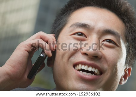 Portrait of young man on the phone, close up