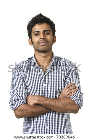 portrait of young man on white background, arms crossed - stock photo