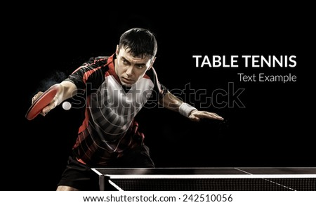 Portrait Of Young Man Playing Tennis On Black Background - stock photo