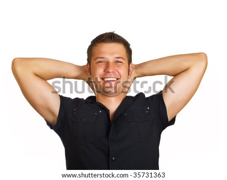 Portrait of young man relaxing with hands on his head - stock photo