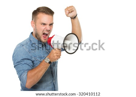 portrait of young man scream throughout a megaphone . isolated over white background