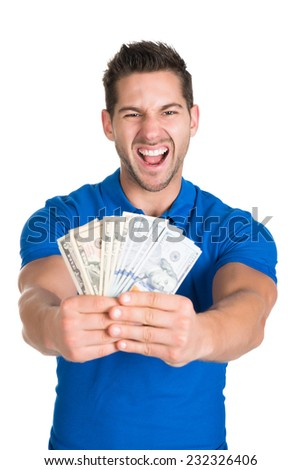 Portrait of young man screaming while holding fanned US paper currency isolated over white background - stock photo