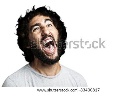 portrait of young man shouting against a white background