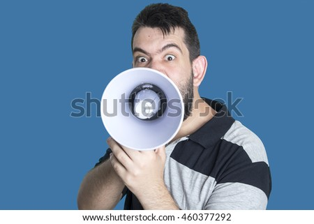 Portrait of young man shouting with megaphone