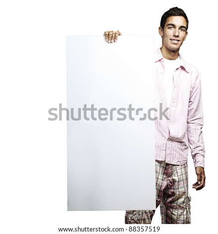 portrait of young man smiling and holding a poster on white background - stock photo