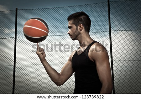 Portrait of young man street basket player - stock photo