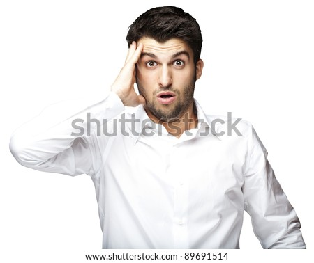 portrait of young man surprised against a white background - stock photo