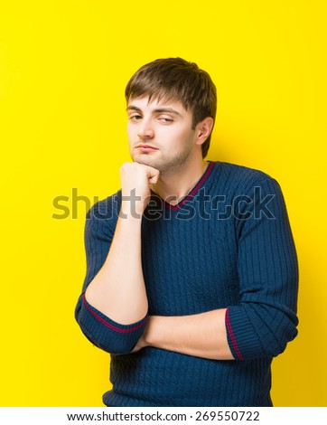 portrait of young man thinking against - stock photo