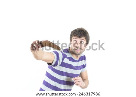 portrait of young man throwing a boomerang - stock photo