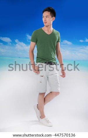portrait of young man walking at beach background - stock photo