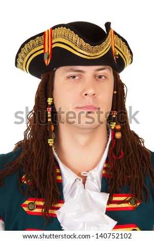 Portrait of young man wearing pirate costume. Isolated on white  - stock photo