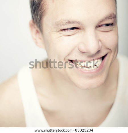 Portrait of young man with a beautiful smile and funny clothes.