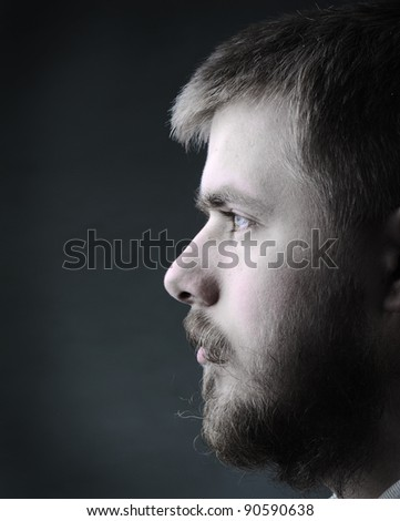 Portrait of young man with beard - stock photo