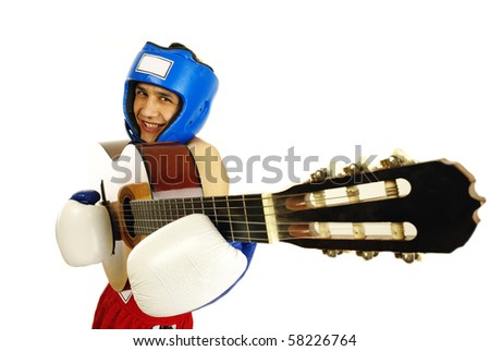 Portrait of young man with boxing gloves and guitar over white background