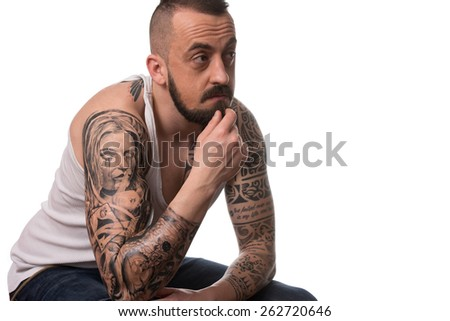 Portrait Of Young Man With Tattoo And Beard - Isolated On White Background - stock photo