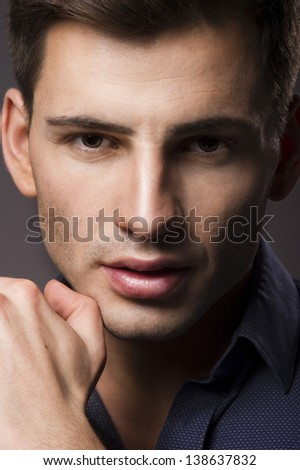 Portrait of young man with very handsome face - stock photo