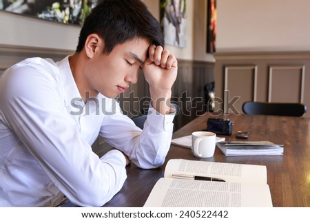 Portrait of young man worried in the interior of coffee shop