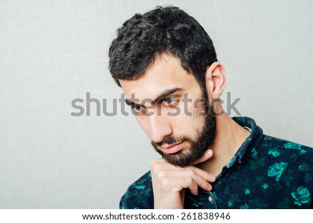 Portrait of young man worrying - stock photo
