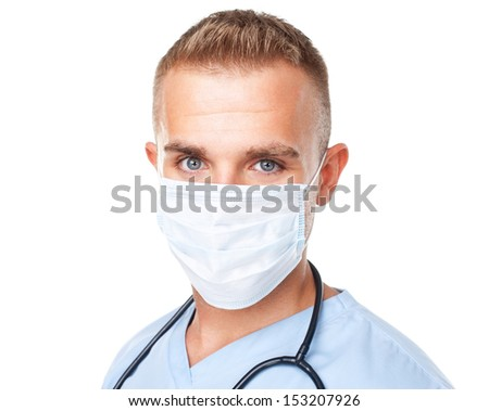 Portrait of young medical doctor in mask isolated on white background