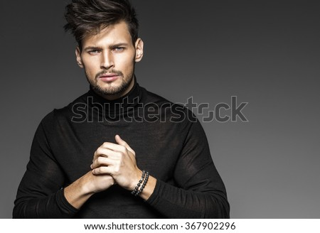 Portrait of young model with clenched hands - stock photo