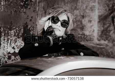 Portrait of young model with sunglasses - stock photo