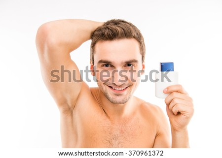 Portrait of young muscular man in bathroom - stock photo