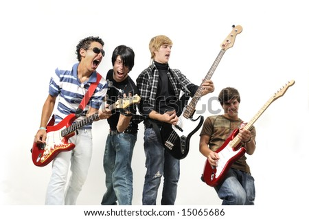 Portrait of young musical band playing with instruments - isolated - stock photo