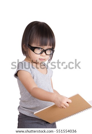 Portrait of young nerdy girl with book, cute girl holding the book.