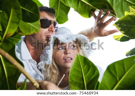 Portrait of young nice couple having good time inj tropic environment - stock photo