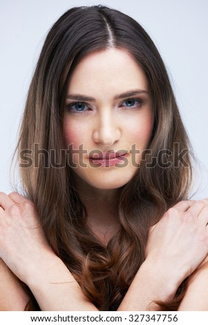portrait of young nude brunette woman isolated in studio - stock photo