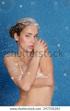 Portrait of young nude sexy women with snow - stock photo