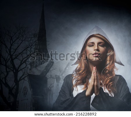 Portrait of young nun - stock photo