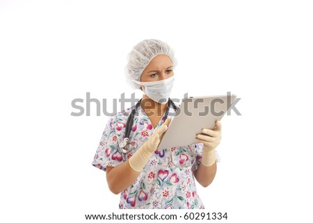Portrait of young nurse  with mask and cap reading medical chart - stock photo