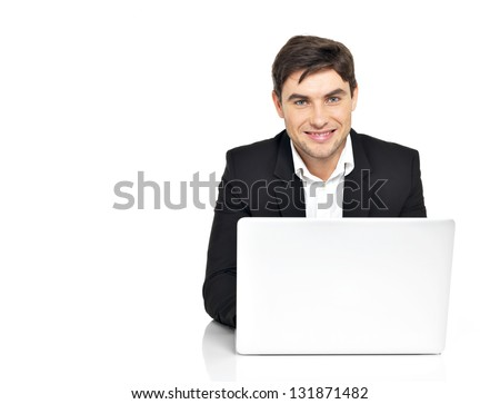 Portrait of young office worker with  laptop sitting on the table  isolated on white. - stock photo